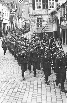 German soldiers on the march. Peter Knowly was probably arrested by the Nazi army but nobody wanted to tell us why and how to make him liberated. It was a bureaucracy of no news and chaos of information.