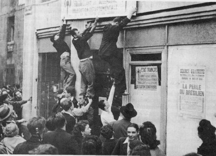 French civilians celebrate the liberation of Besancon. During the Germans, Velvet Eyes Was There To Rescue A Friend With The Resistance.
