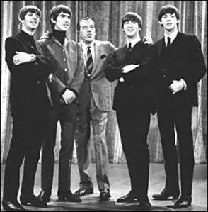 The Beatles are the group that travelled to the United States to meet Ed Sullivan, the TV host of the Americans in the 1960's in order to propose songs from the UK, inspired by the nuclear bomb.