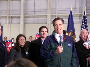 Mitt Romney and family members : a permanent smile.