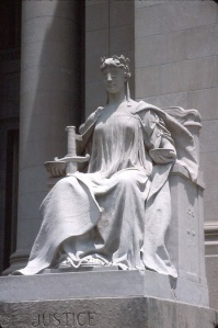 The law is the main text that the Justice enforces. It creates security and work for everybody (almost). Statue at Shelby County Courthouse, located in Memphis, Tennessee. Photo by Einar Einarsson Kvaran aka Carptrash 19:52, 12 October 2006 (UTC) .