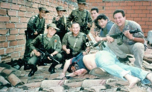 NO DRUG WITHOUT A DOCTOR. Mike Fuller said. DEATH FOR DEALERS when ILLEGAL. Members of Colonel Martinez's Search Bloc celebrate over Pablo Escobar's body on December 2, 1993. Pablo's death ended a fifteen-month effort that cost hundreds of millions of dollars.