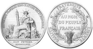Les deux faces du sceau en application de l'arrêté du 18 septembre 1848.  REPUBLIQUE FRANÇAISE DEMOCRATIQUE UNE ET INDIVISIBLE. The France with radiate crown, sitting and holding fasces in r. hand. In exergue XXIV FEVRIER // MDCCCXLVIIIEGALITE • FRATERNITE • LIBERTE. In field AU NOM // DU PEUPLE // FRANÇAIS in three lines. Crown: oak left & olive r.  Source L'Illustration, 1848-10-28. Author: Jacques-Jean Barre (1793–1855).
